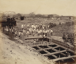 View of bridge on main [railway] line across minor dam [Victoria Dock construction, Bombay].
